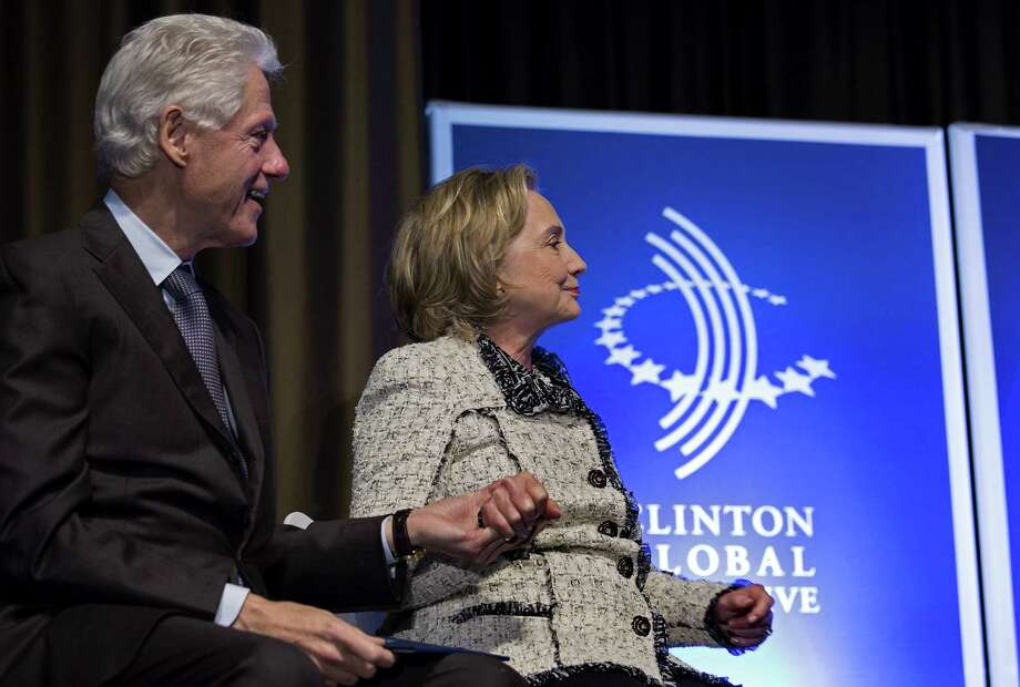 Bill and Hillary Clinton are already getting on American's nerves as the early 2016 buildup for a possible Hillary Clinton presidential bid brings their money-grubbing ways back into the spotlight. Photo: Associated Press