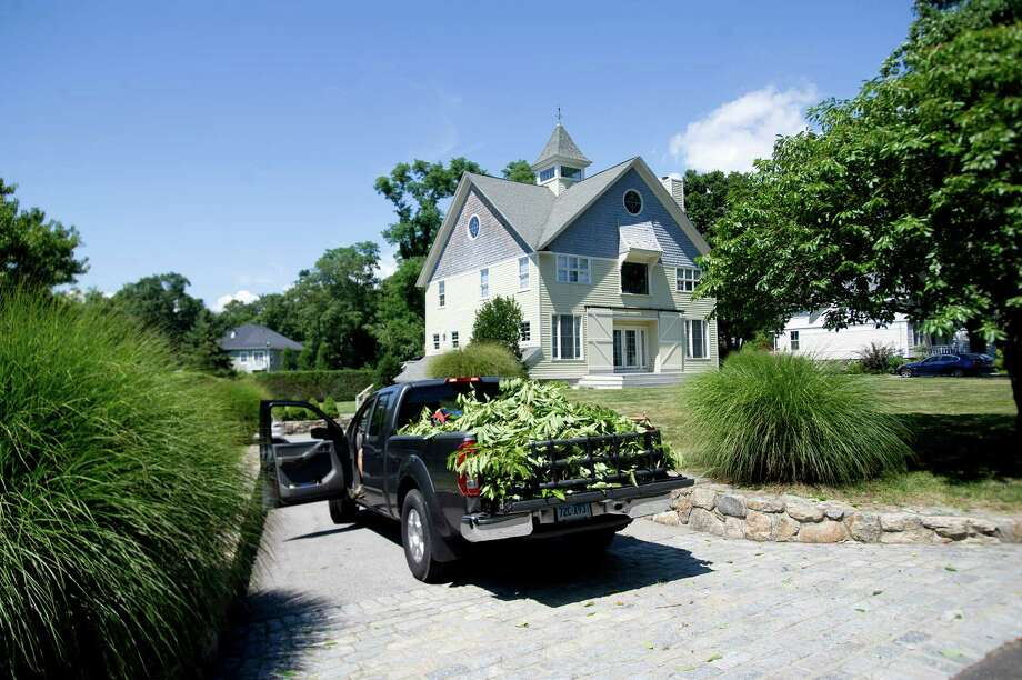 A truck filled with branches and yard waste sits in the driveway of Connecticut Governor Dannel Malloy's Stamford home on Ocean Drive East on Saturday, August 17, 2013. Photo: Lindsay Perry / Stamford Advocate