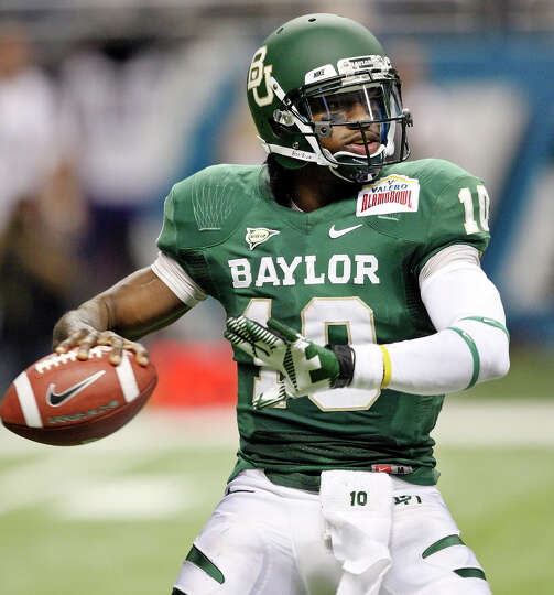 FOR SPORTS - Baylor's Robert Griffin III looks to pass against Washington during first half action o