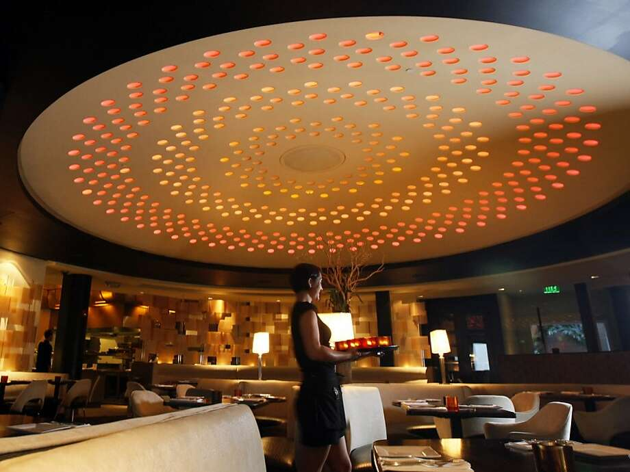 "5A5 Steak Lounge's main dining room, with its large, perforated dome, has a cool, futuristic style that's a bit reminiscent of ""The Jetsons."" Photo: Lance Iversen, The Chronicle"