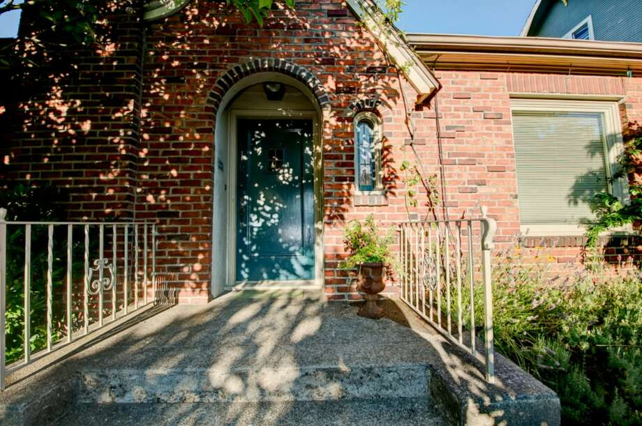 If you have just about $600,000 to spend, there's a selection of charming old homes for sale in Queen Anne right now. Here they are, starting with 2616 Queen Anne Ave. N. The 2,640-square-foot brick Tudor, built in 1927, has two bedrooms, one bathroom, mahogany millwork, leaded windows, coved ceilings, built-ins, an unfinished basement, decks and a patio on a 2,640-square-foot lot. It's listed for $588,000. Photo: Courtesy Mary Schile, RE/MAX-Metro Realty