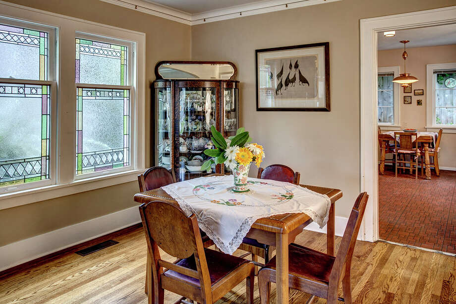 Dining room of 2453 4th Ave. W. It's listed for $589,000. Photo: John G. Wilbanks Photography, Courtesy Carrie Simmons, Coldwell Banker Bain