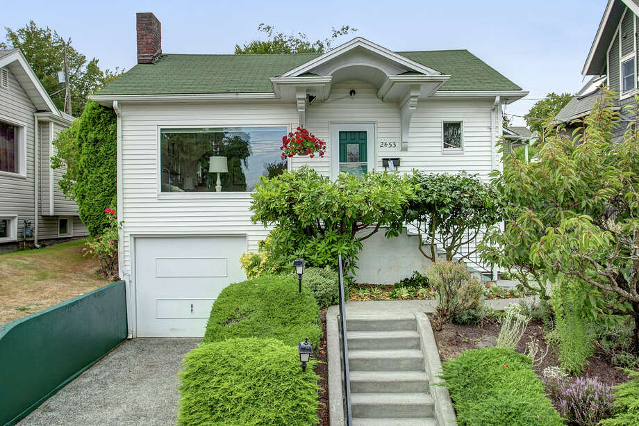 Listed for $1,000 more is 2453 4th Ave. W. The 2,180-square-foot house, built in 1924, has three bedrooms and two bathrooms, including a basement apartment, coved ceilings and leaded glass on a 3,200-square-foot lot. Photo: John G. Wilbanks Photography,  Courtesy Carrie Simmons,  Coldwell Banker Bain