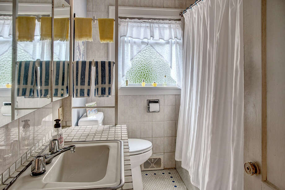 Bathroom of 2453 4th Ave. W. It's listed for $589,000. Photo: John G. Wilbanks Photography, Courtesy Carrie Simmons, Coldwell Banker Bain