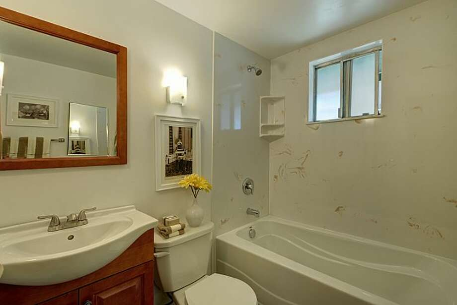 Bathroom of 307 W. Blaine St. It's listed for $595,000. Photo: Courtesy Randie Nelson, Windermere Real Estate