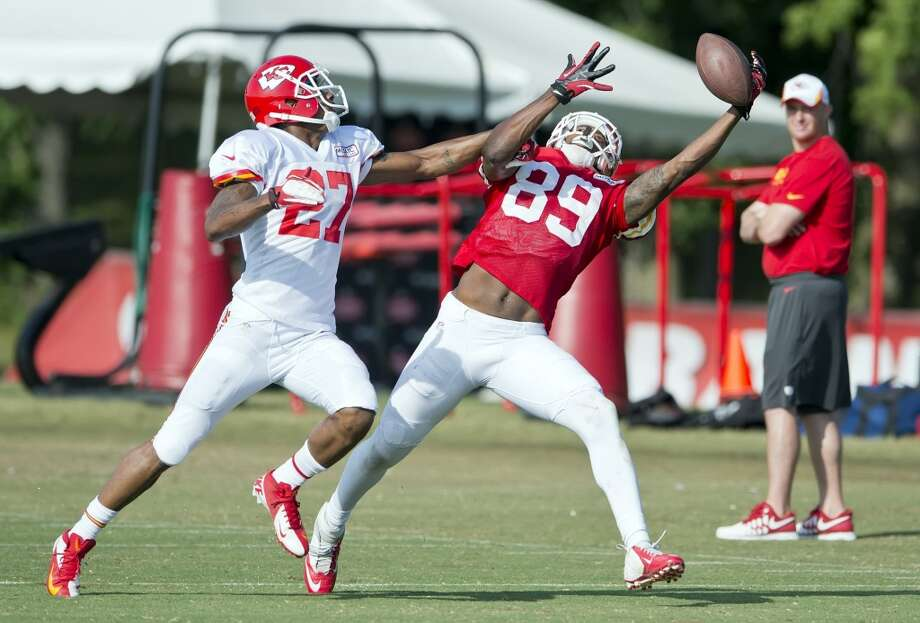 Kansas City Chiefs wide receiver Jon Baldwin (89) could not catch a pass over the defense of cornerback Sean Smith (27) during morning practice at the team's training camp on Saturday, August 3, 2013. Photo: David Eulitt, McClatchy-Tribune News Service