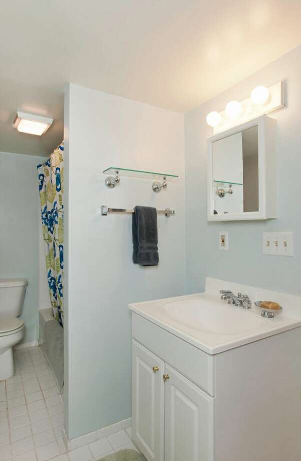 Bathroom of 109 Newell St. It's listed for $595,000. Photo: Courtesy Ellen Gillette, Windermere Real Estate