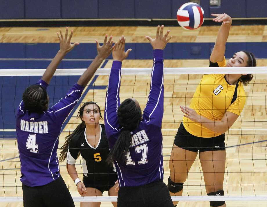 Brennan's Brianna Jordan, right, tries to get a shot past Warren's Maliya Evans and Bobbie Barnes as teammate Natika Sauceda looks on in Saturday's 2013 Northside Volleyball tournament.
