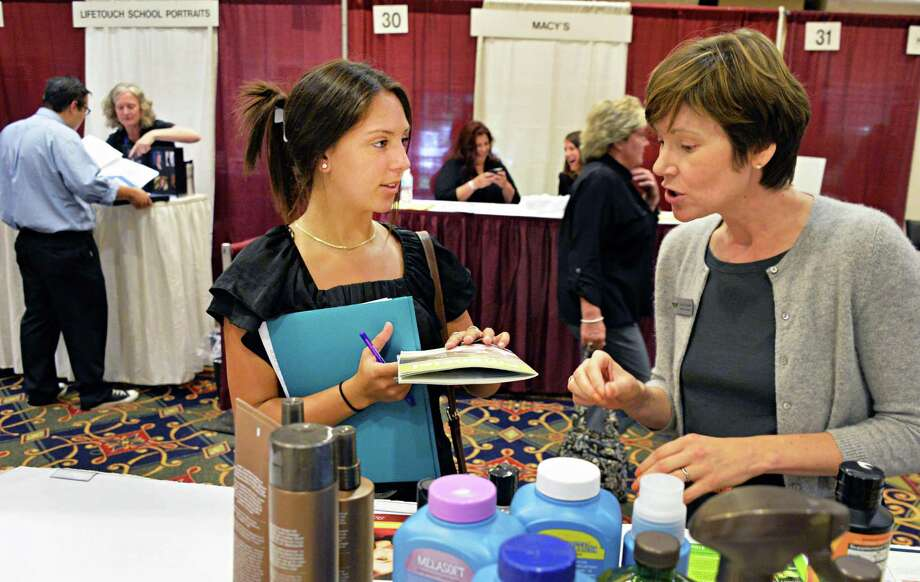 New college grad Brianne Palermo, left, of Troy and indepenent marketing executive Cheryl Paulsen at the Times Union job fair at the Albany Marriott in Colonie, NY, Wednesday July 24, 2013.  (John Carl D'Annibale / Times Union) Photo: John Carl D'Annibale / 00023172A