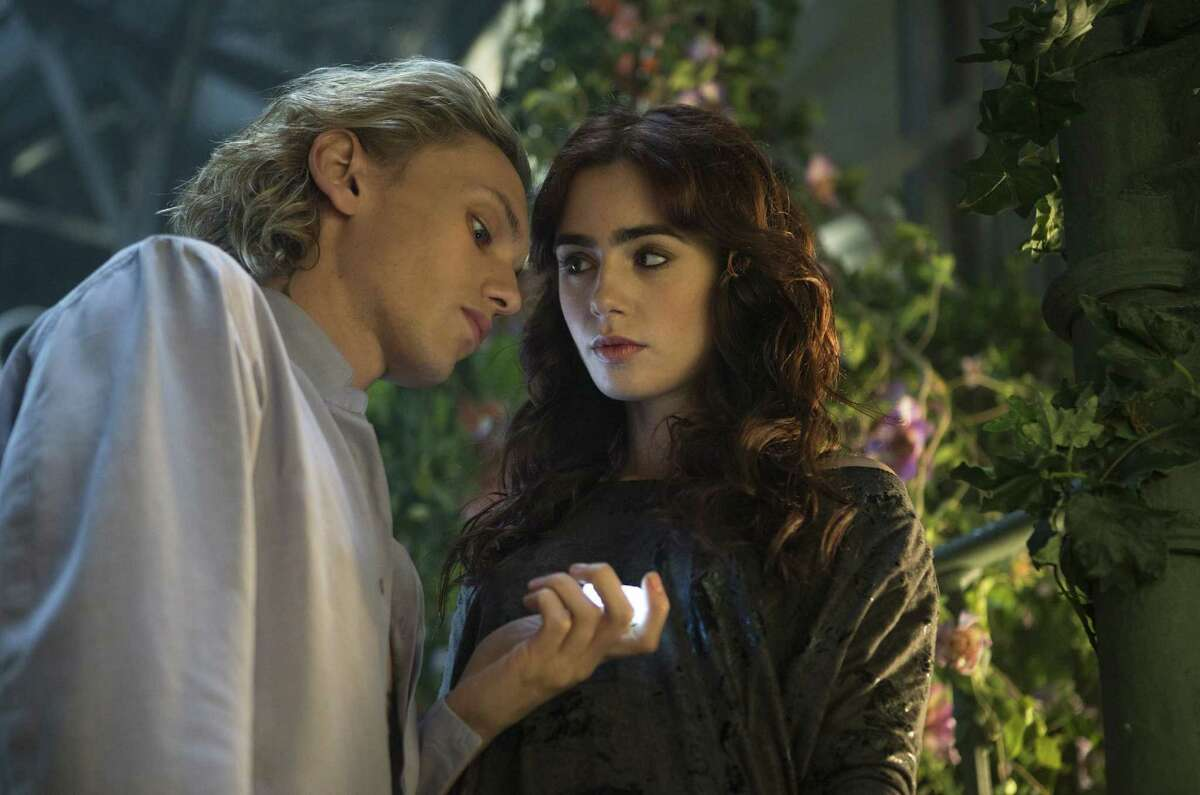 """Jace (Jamie Campbell Bower) and Clary (Lily Collins) join forces to defeat a traitor in """"The Mortal Instruments: City of Bones."""""""