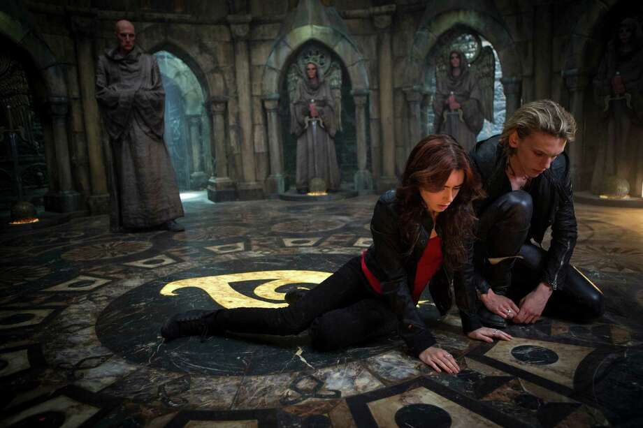 "Jamie Campbell Bower as Jace, right,  and Lilly Collins as Clary in a scene from ""The Mortal Instruments: City of Bones. (AP Photo/Sony Pictures Screen Gems, Rafy) Photo: Rafy, HOEP / Sony Pictures Screen Gems"