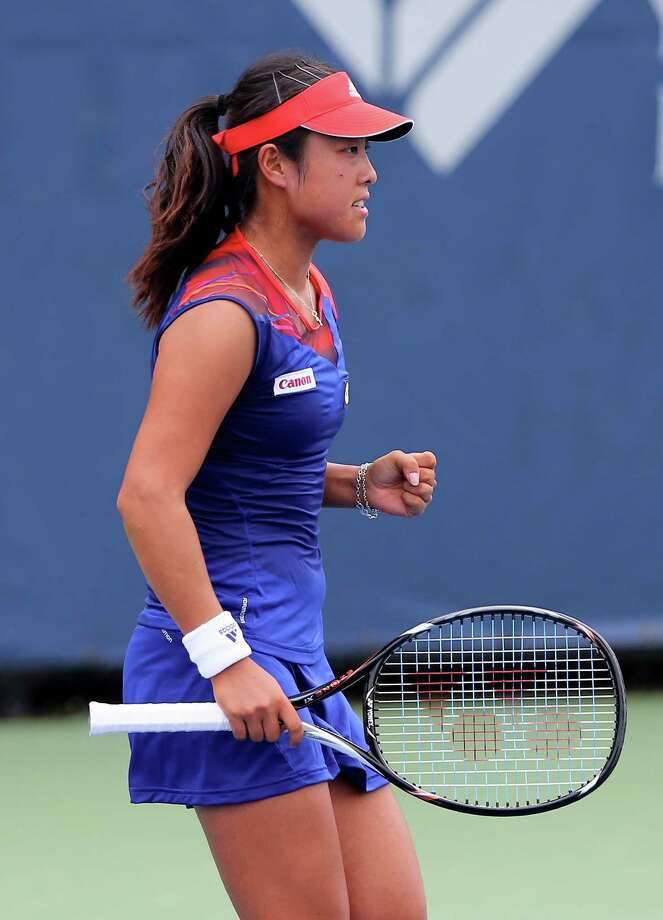 NEW HAVEN, CT - AUGUST 18:  Ayumi Morita of Japan celebrates a point win over Mariana Duque-Marino of Colombia during Day One of the New Haven Open at Connecticut Tennis Center at Yale on August 18, 2013 in New Haven, Connecticut. Photo: Elsa, Getty Images / 2013 Getty Images