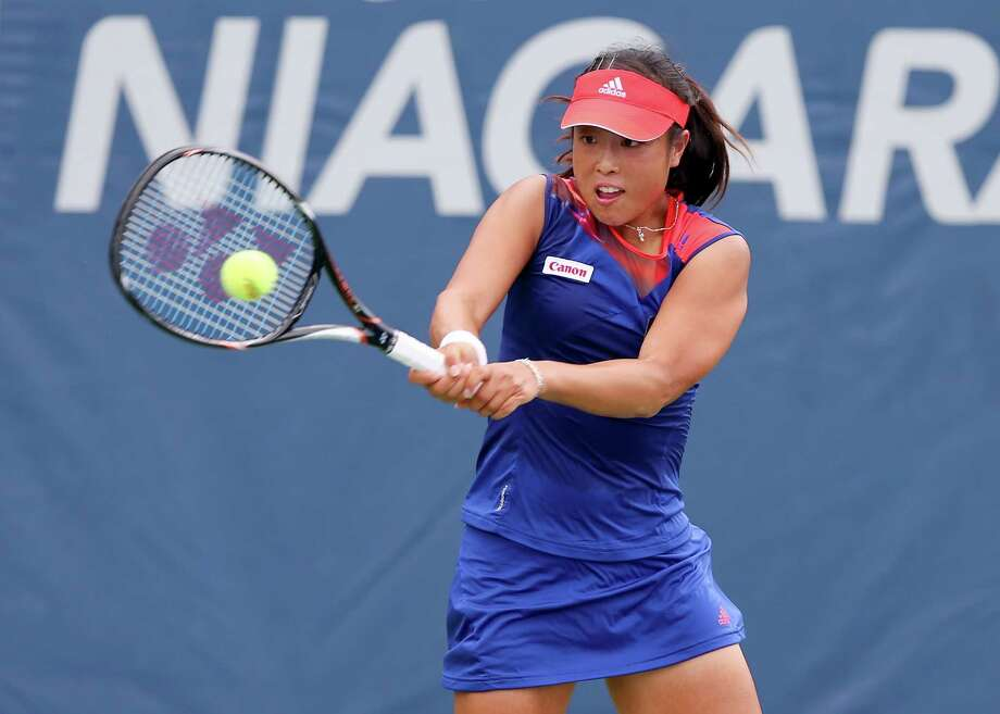 NEW HAVEN, CT - AUGUST 18:  Ayumi Morita of Japan returns a shot to Mariana Duque-Marino of Colombia during Day One of the New Haven Open at Connecticut Tennis Center at Yale on August 18, 2013 in New Haven, Connecticut. Photo: Elsa, Getty Images / 2013 Getty Images