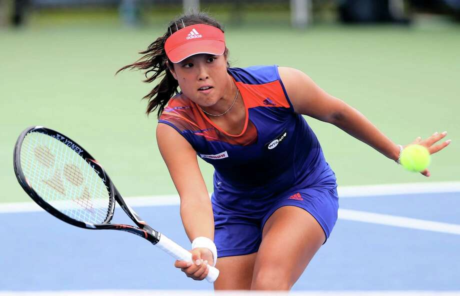 NEW HAVEN, CT - AUGUST 18:  Ayumi Morita of Japan returns a shot to Mariana Duque-Marino of Colombia during the New Haven Open at Connecticut Tennis Center at Yale on August 18, 2013 in New Haven, Connecticut. Photo: Elsa, Getty Images / 2013 Getty Images