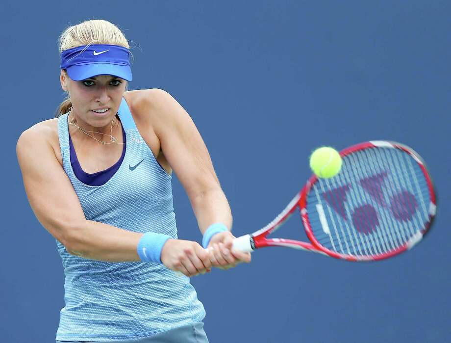 NEW HAVEN, CT - AUGUST 18:  Sabine Lisicki of Germany returns a shot to Kristina Mladenovic of France in the first set during Day One of the New Haven Open at Connecticut Tennis Center at Yale on August 18, 2013 in New Haven, Connecticut. Photo: Elsa, Getty Images / 2013 Getty Images