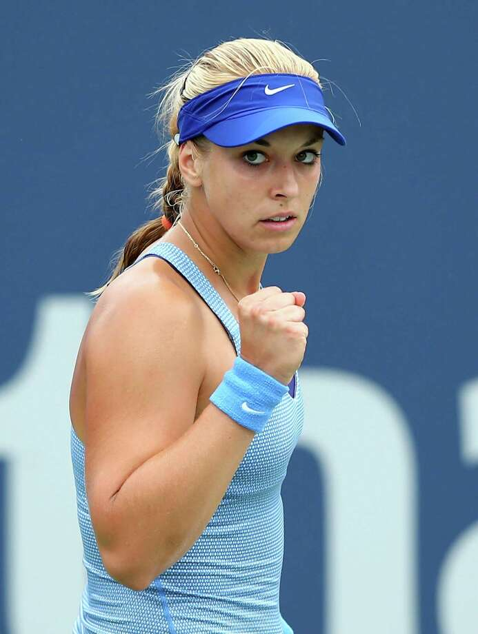 NEW HAVEN, CT - AUGUST 18:  Sabine Lisicki of Germany celebrates after winning the first set against Kristina Mladenovic of France during Day One of the New Haven Open at Connecticut Tennis Center at Yale on August 18, 2013 in New Haven, Connecticut. Photo: Elsa, Getty Images / 2013 Getty Images