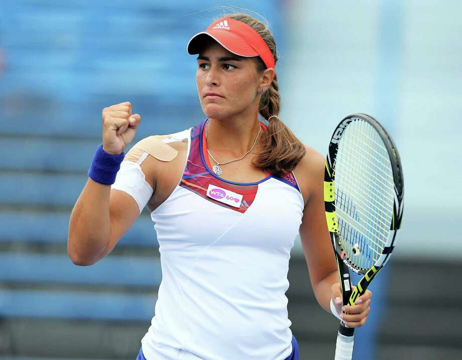 NEW HAVEN, CT - AUGUST 18:  Monica Puig of Puerto Rico a point win over Caroline Garcia of France during Day One of the New Haven Open at Connecticut Tennis Center at Yale on August 18, 2013 in New Haven, Connecticut. Photo: Elsa, Getty Images / 2013 Getty Images