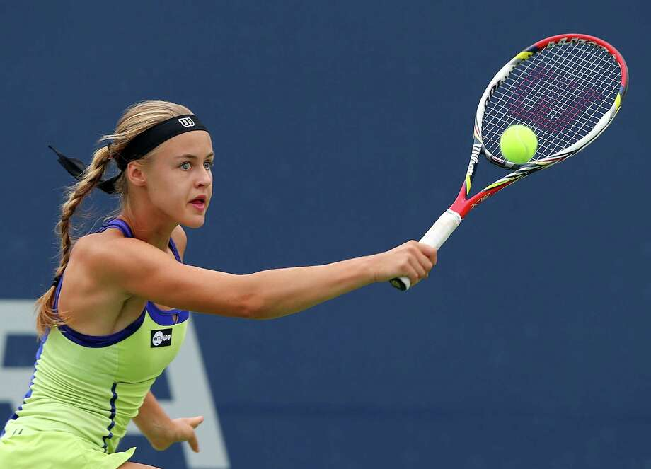 NEW HAVEN, CT - AUGUST 19:  Anna Schmiedlova of Slovakia returns a shot to Sloane Stephens of the USA during Day Two of the New Haven Open at the Connecticut Tennis Center at Yale on August 19, 2013 in New Haven, Connecticut. Photo: Elsa, Getty Images / 2013 Getty Images
