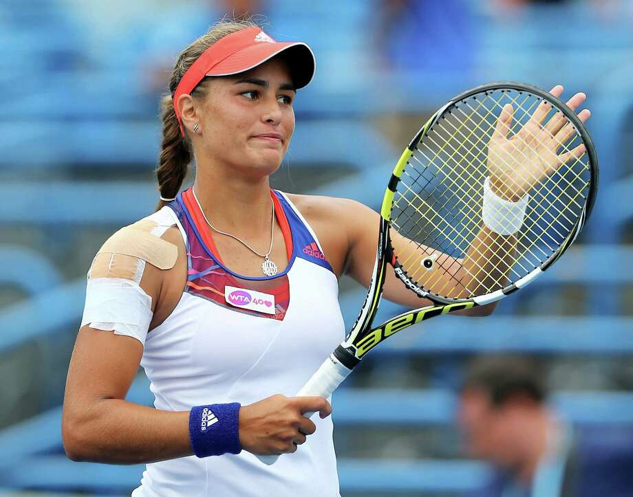 NEW HAVEN, CT - AUGUST 18:  Monica Puig of Puerto Rico celebrates her match win over Caroline Garcia of France during Day One of the New Haven Open at Connecticut Tennis Center at Yale on August 18, 2013 in New Haven, Connecticut. Photo: Elsa, Getty Images / 2013 Getty Images