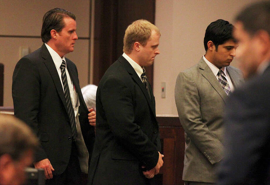 Jeffrey Eugene Theisen (center) walks away from the judge's bench with his attorneys as the jury returned with guilty conviction of intoxication manslaughter and handed Theisen a 13-year sentence for the death of Christina Renee Flores at the 399th District Court on Tuesday, Aug. 20, 2013. Theisen crashed into Flores in 2011 by going the wrong way on Interstate 37 while intoxicated. Photo: Kin Man Hui, San Antonio Express-News / ©2013 San Antonio Express-News