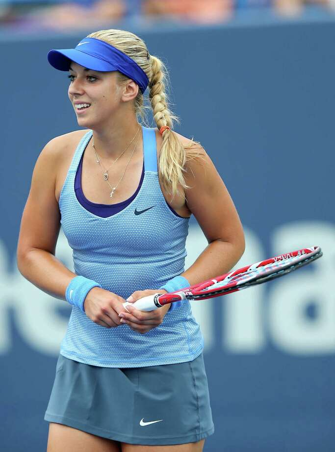 NEW HAVEN, CT - AUGUST 18:  Sabine Lisicki of Germany celebrates a point win in the first set against Kristina Mladenovic of France during Day One of the New Haven Open at Connecticut Tennis Center at Yale on August 18, 2013 in New Haven, Connecticut. Photo: Elsa, Getty Images / 2013 Getty Images