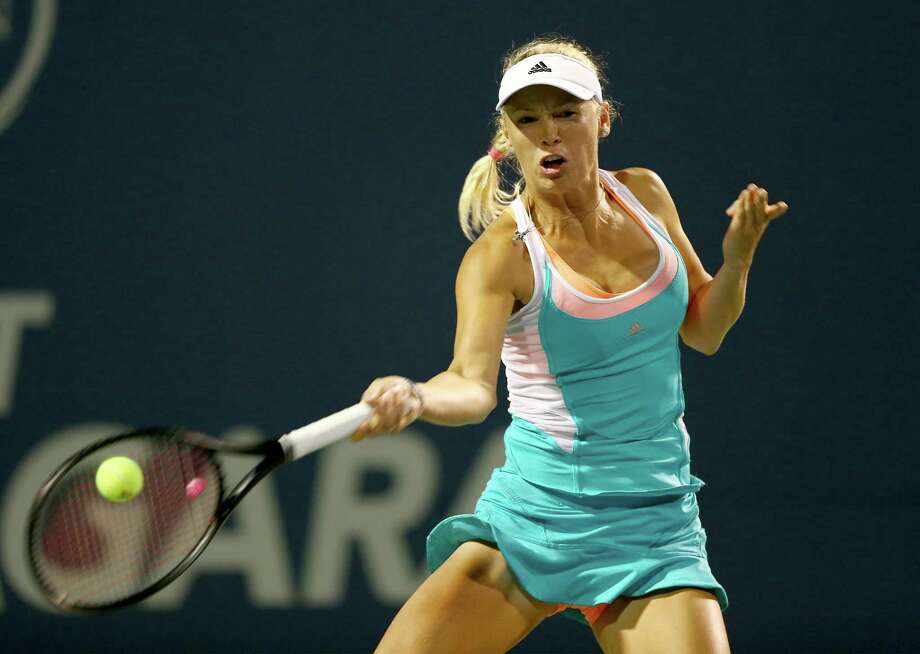 NEW HAVEN, CT - AUGUST 19:  Caroline Wozniacki of Denmark returns a shot to Shuai Peng of China during Day Two of the New Haven Open at the Connecticut Tennis Center at Yale on August 19, 2013 in New Haven, Connecticut. Photo: Elsa, Getty Images / 2013 Getty Images