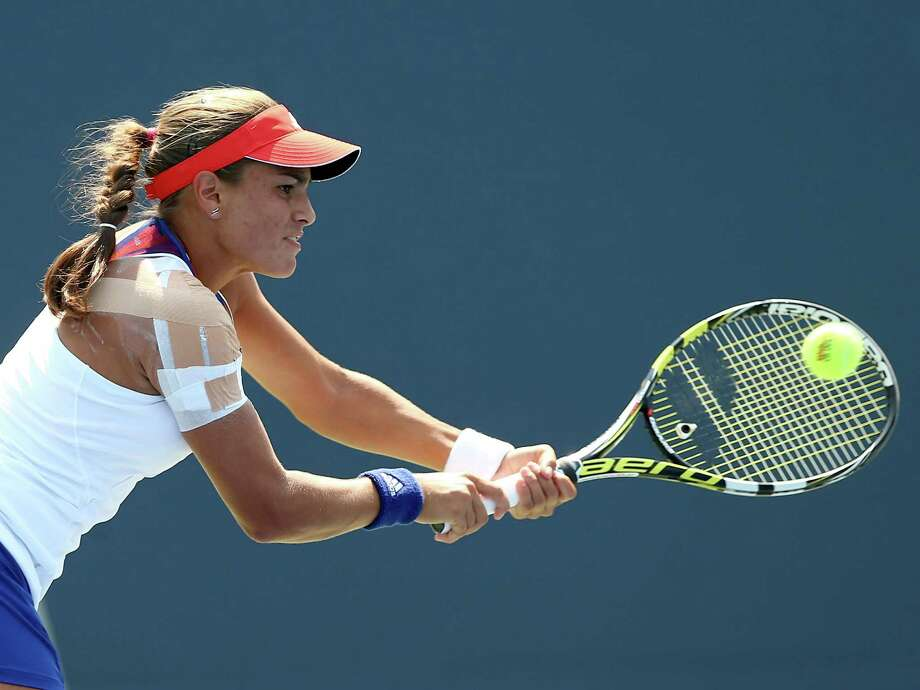 NEW HAVEN, CT - AUGUST 20:  Monica Puig of Puerto Rico returns a shot to Klara Zakopalova of the Czech Republic during Day Three of the New Have Open at Connecticut Tennis Center at Yale on August 20, 2013 in New Haven, Connecticut. Photo: Elsa, Getty Images / 2013 Getty Images