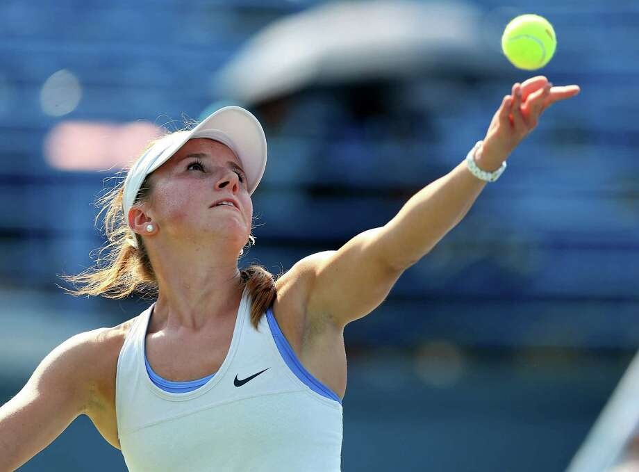 NEW HAVEN, CT - AUGUST 20:  Annika Beck of Germany serves the ball to Petra Kvitova of the Czech Republic during Day Three of the New Have Open at Connecticut Tennis Center at Yale on August 20, 2013 in New Haven, Connecticut. Photo: Elsa, Getty Images / 2013 Getty Images