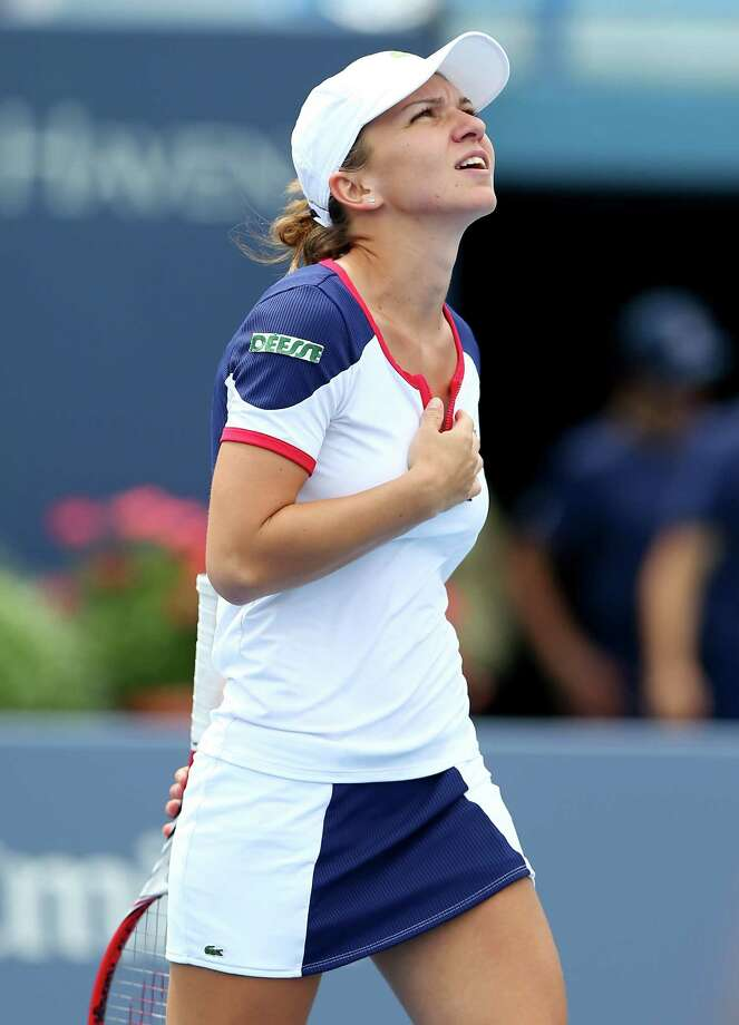 NEW HAVEN, CT - AUGUST 19:  Simona Halep of Romania celebrates her match win over Daniela Hantuchova of Slovakia during Day Two of the New Haven Open at the Connecticut Tennis Center at Yale on August 19, 2013 in New Haven, Connecticut. Photo: Elsa, Getty Images / 2013 Getty Images
