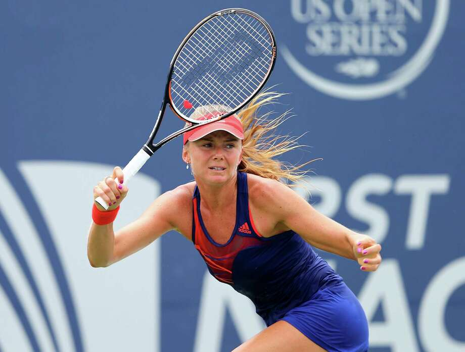 NEW HAVEN, CT - AUGUST 19:  Daniela Hantuchova of Slovakia returns a shot to Simona Halep of Romania during Day Two of the New Haven Open at the Connecticut Tennis Center at Yale on August 19, 2013 in New Haven, Connecticut. Photo: Elsa, Getty Images / 2013 Getty Images