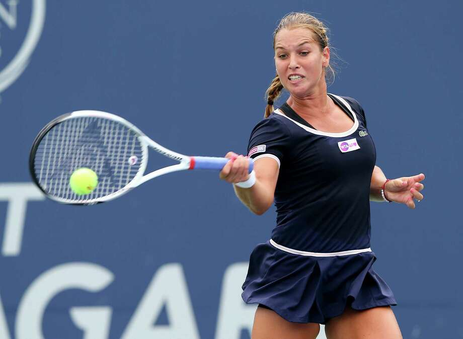NEW HAVEN, CT - AUGUST 19:  Dominika Cibulkova of Slovakia returns a shot to Klara Zakopalova of the Czech Republic during Day Two of the New Haven Open at the Connecticut Tennis Center at Yale on August 19, 2013 in New Haven, Connecticut. Photo: Elsa, Getty Images / 2013 Getty Images