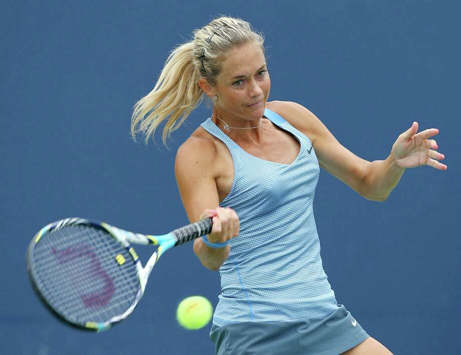 NEW HAVEN, CT - AUGUST 19:  Klara Zakopalova of the Czech Republic returns a shot to Dominika Cibulkova of Slovakia during Day Two of the New Haven Open at the Connecticut Tennis Center at Yale on August 19, 2013 in New Haven, Connecticut. Photo: Elsa, Getty Images / 2013 Getty Images