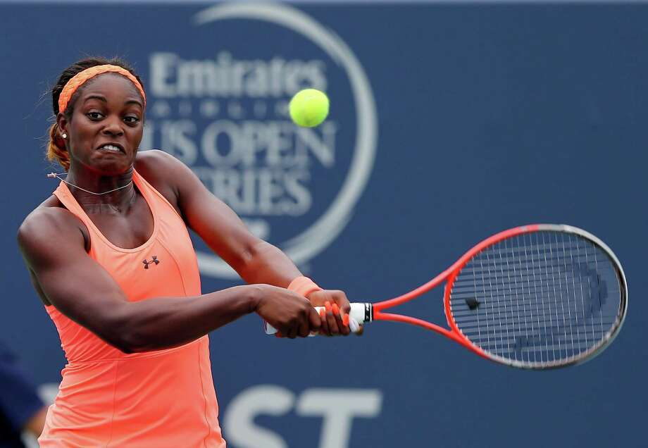NEW HAVEN, CT - AUGUST 19:  Sloane Stephens of the USA returns a shot to Anna Schmiedlova of Slovakia during Day Two of the New Haven Open at the Connecticut Tennis Center at Yale on August 19, 2013 in New Haven, Connecticut. Photo: Elsa, Getty Images / 2013 Getty Images