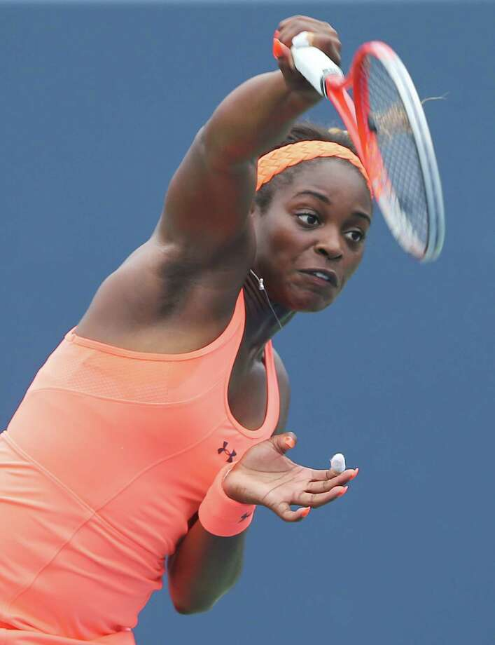 NEW HAVEN, CT - AUGUST 19:  Sloane Stephens of the USA serves the ball to Anna Schmiedlova of Slovakia during Day Two of the New Haven Open at the Connecticut Tennis Center at Yale on August 19, 2013 in New Haven, Connecticut. Photo: Elsa, Getty Images / 2013 Getty Images