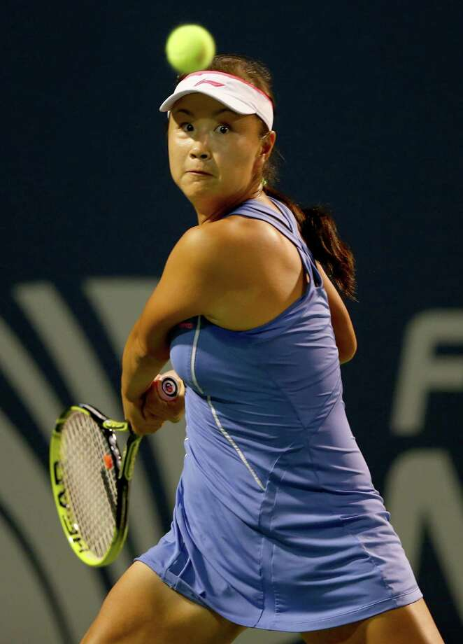 NEW HAVEN, CT - AUGUST 19:  Shuai Peng of China returns a shot to Caroline Wozniacki of Denmark in the first set during Day Two of the New Haven Open at the Connecticut Tennis Center at Yale on August 19, 2013 in New Haven, Connecticut. Photo: Elsa, Getty Images / 2013 Getty Images