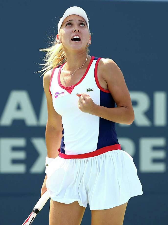 NEW HAVEN, CT - AUGUST 20:  Elena Vesnina of Russia celebrates a point win over Angelique Kerber of Germany during Day Three of the New Have Open at Connecticut Tennis Center at Yale on August 20, 2013 in New Haven, Connecticut. Photo: Elsa, Getty Images / 2013 Getty Images