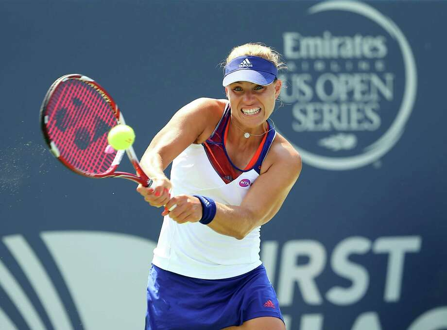 NEW HAVEN, CT - AUGUST 20:  Angelique Kerber of Germany returns a shot to Elena Vesnina of Russia during Day Three of the New Have Open at Connecticut Tennis Center at Yale on August 20, 2013 in New Haven, Connecticut. Photo: Elsa, Getty Images / 2013 Getty Images