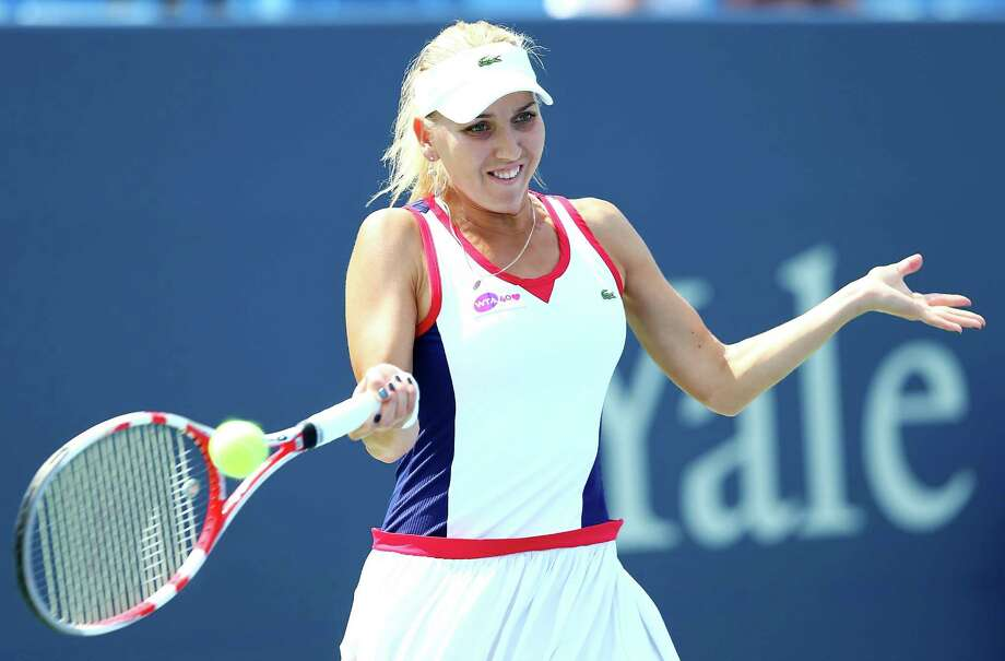 NEW HAVEN, CT - AUGUST 20:  Elena Vesnina of Russia returns a shot to Angelique Kerber of Germany during Day Three of the New Have Open at Connecticut Tennis Center at Yale on August 20, 2013 in New Haven, Connecticut. Photo: Elsa, Getty Images / 2013 Getty Images