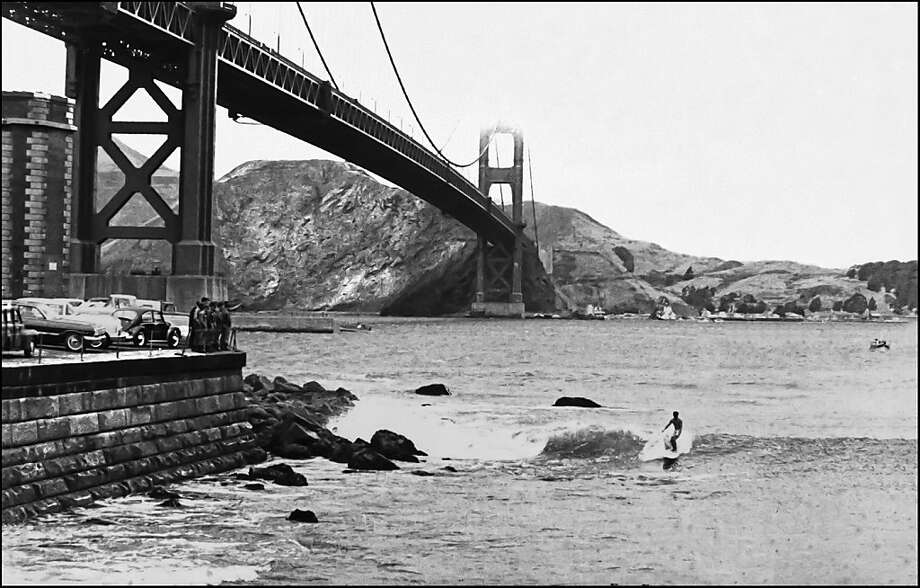 This image of John Childs at Fort Point is by Fred Windisch, whose surf photography is being shown at Madrone Art Bar. Photo: Fred Windisch, Family Of Fred Windisch
