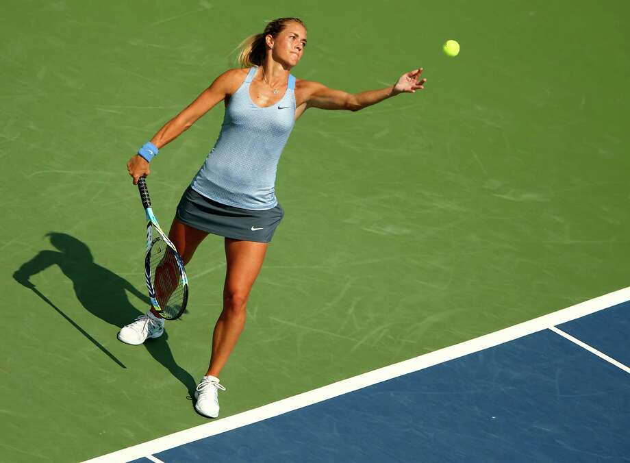 NEW HAVEN, CT - AUGUST 20:  Klara Zakopalova of the Czech Republic serves the ball to Monica Puig of Puerto Rico during Day Three of the New Have Open at Connecticut Tennis Center at Yale on August 20, 2013 in New Haven, Connecticut. Photo: Elsa, Getty Images / 2013 Getty Images