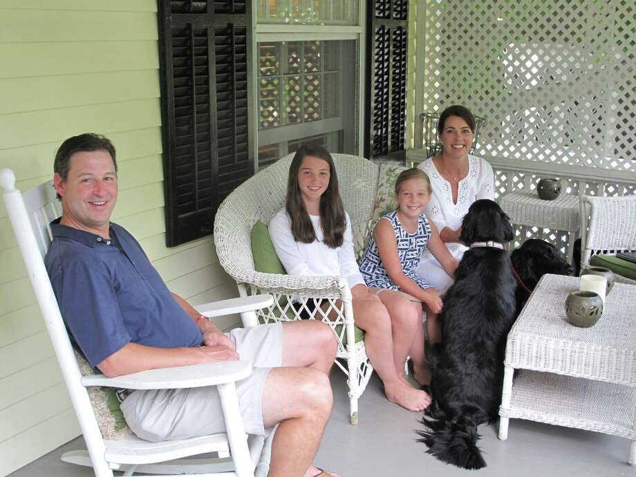 The Kennellys enjoy their porch on St. Johns Place. From left (humans): John, Katie, Lucy, and Liz. Photo: Tyler Woods