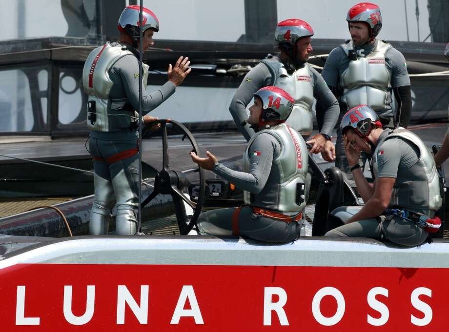 Sailors of the Luna Rossa boat talk amongst themselves after losing to Emirates Team New Zealand when a portion of Luna Rossa's sail broke during Race 3 of the Louis Vuitton Cup Finals on Monday, August 19, 2013 in San Francisco, Calif. Photo: Beck Diefenbach, Special To The Chronicle