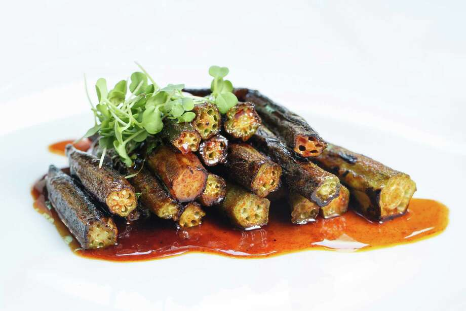 Charred Okra and Maple Glaze is a standout side dish on the lunch menu. Photo: Michael Paulsen, Staff / © 2013 Houston Chronicle