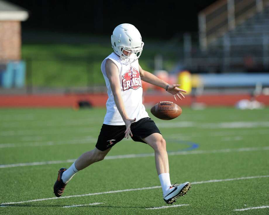 Greenwich High School kicker Peter Heerdt during football practice at Cardinal Stadium, Tuesday night, August 20, 2013. Photo: Bob Luckey / Greenwich Time