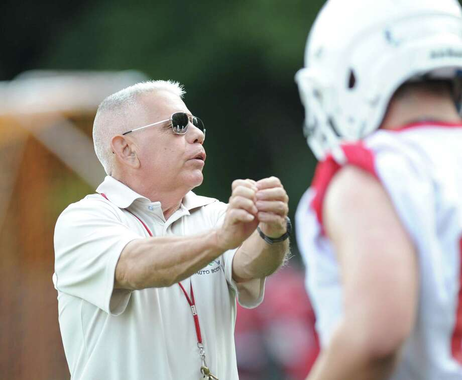 Greenwich High School assistant football coach Carl Cairo during football practice at Cardinal Stadium, Tuesday night, August 20, 2013. Photo: Bob Luckey / Greenwich Time