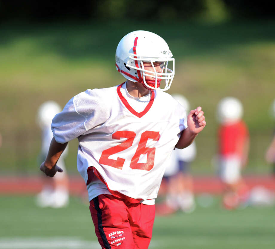 Greenwich High School running back Nick Shepis during football practice at Cardinal Stadium, Tuesday night, August 20, 2013. Photo: Bob Luckey / Greenwich Time