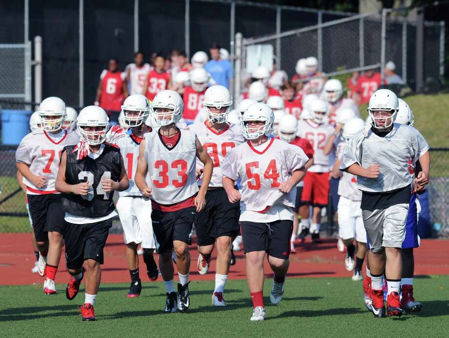 Greenwich High School football practice at Cardinal Stadium, Tuesday night, August 20, 2013. Photo: Bob Luckey / Greenwich Time