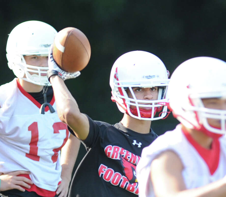 Greenwich High School quarterback Austin Longi throws during football practice at Cardinal Stadium, Tuesday night, August 20, 2013. Photo: Bob Luckey / Greenwich Time