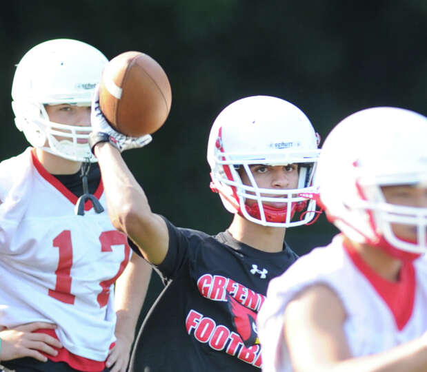 Greenwich High School quarterback Austin Longi throws during football practice at Cardinal Stadium,