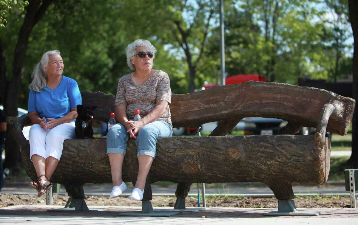 Julia Pendleton, her dog Suzi Q, and Hope Barley sit in the shade on the newly installed furniture at the Navigation Boulevard Esplanade.